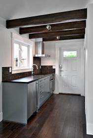 A small laneway house designed to blend with its traditional neighbors. The 400 sq ft cottage is a studio design with a sleeping loft. | www.facebook.com/SmallHouseBliss